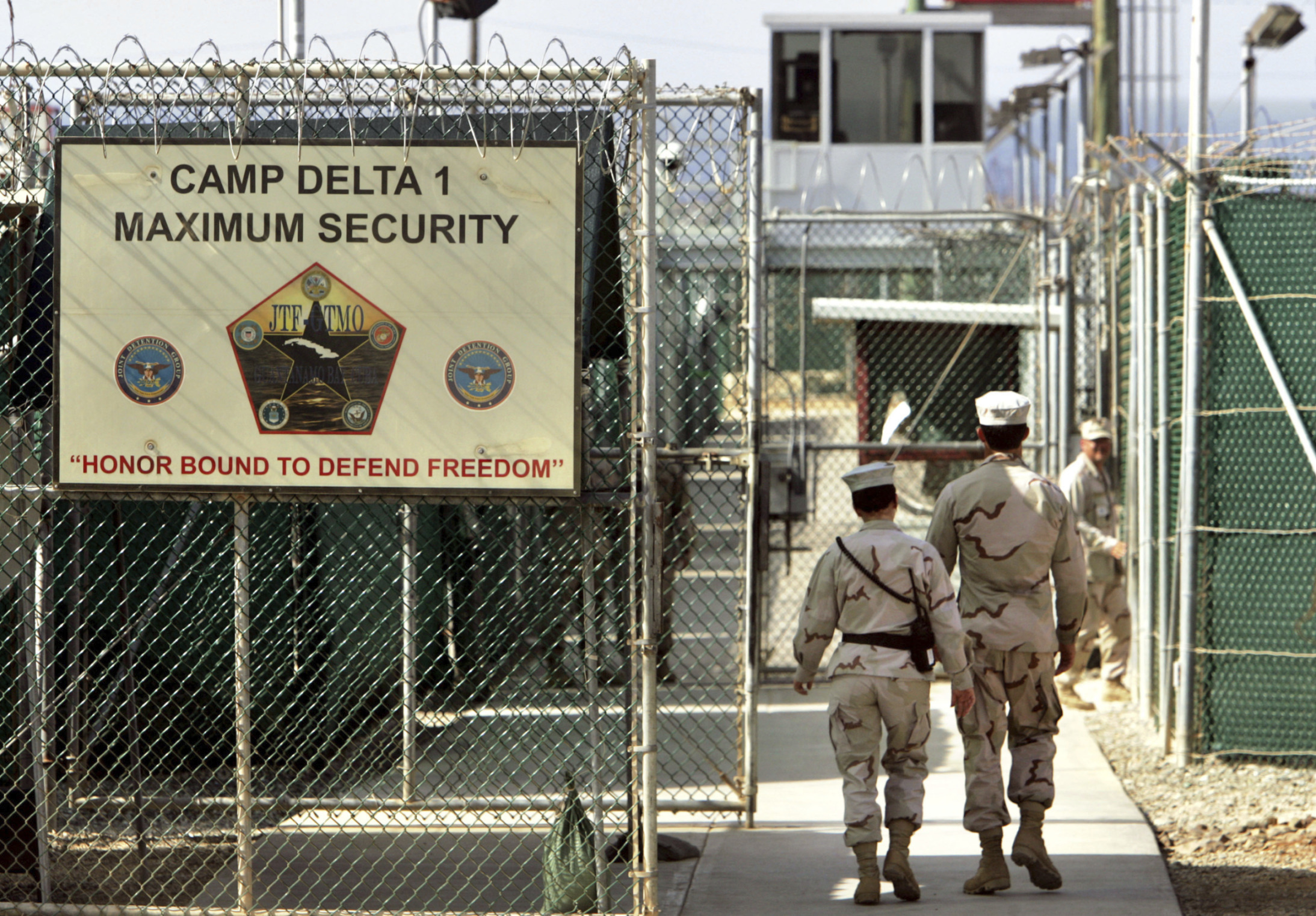 In this file photo, reviewed by a US Department of Defense official, US military guards walk within Camp Delta military-run prison, at the Guantanamo Bay US Naval Base, Cuba. AP