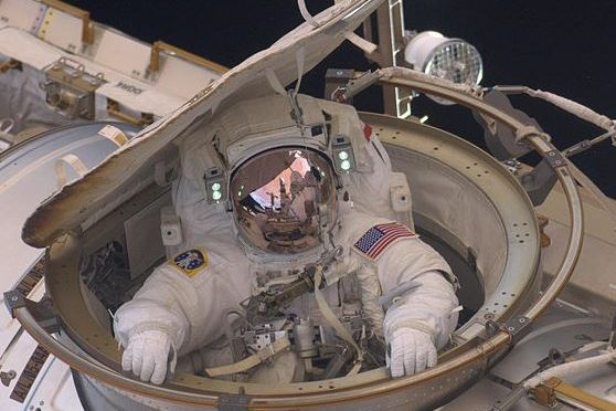 Two US spacewalkers leave station to replace failed computer
